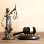 Lawyer's desk with lady justice and gavel