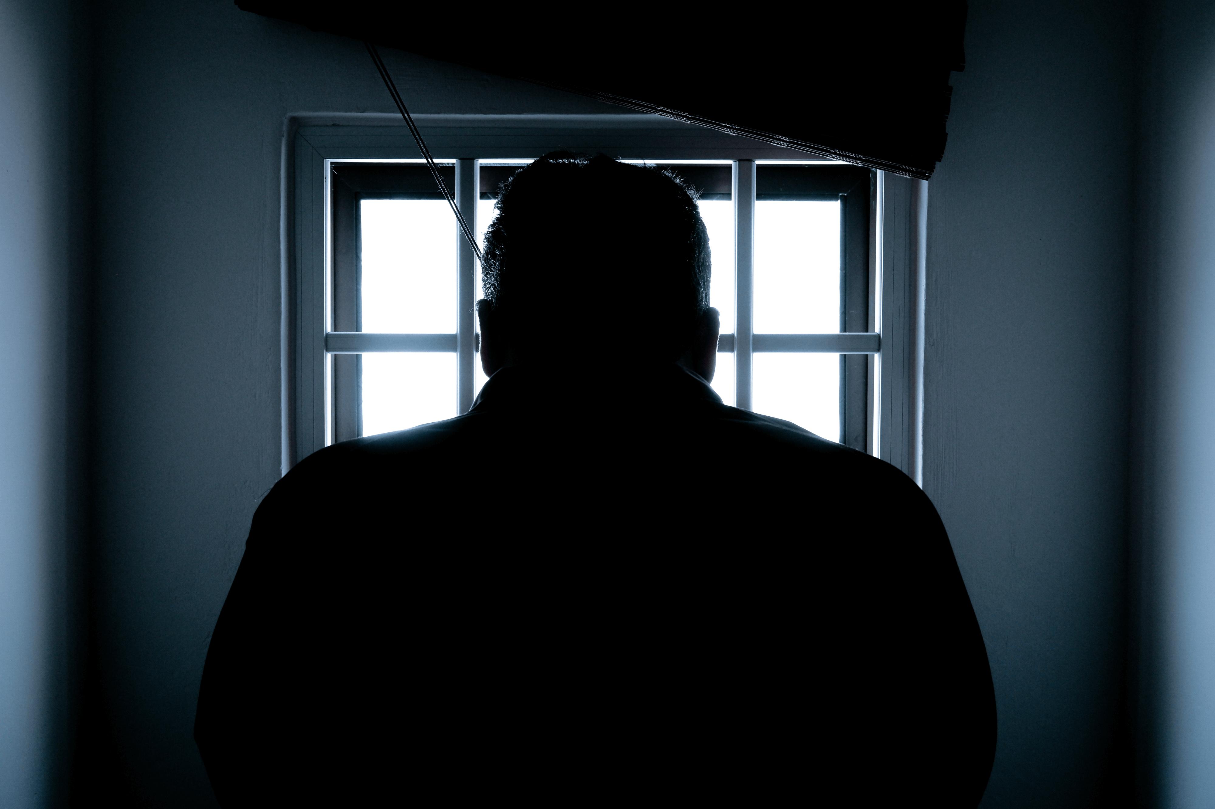 Silhouette Man in the Window
