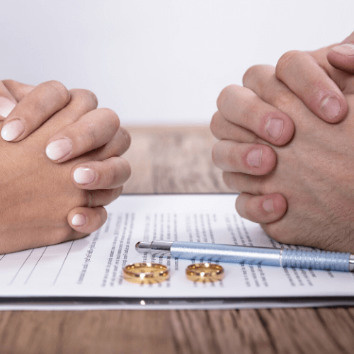 Hands over a divorce document